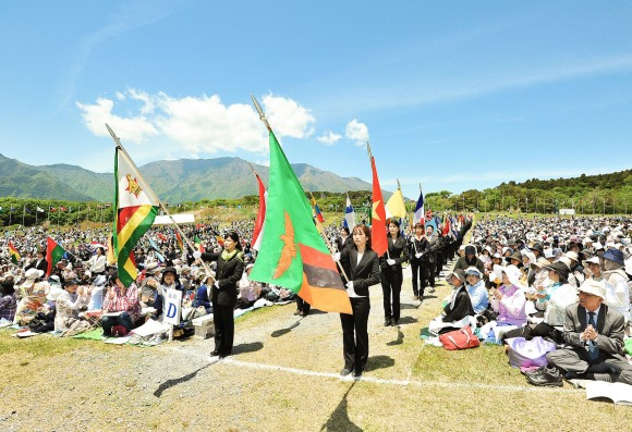 Carrying the national flags through the Prayer Field at the 2014 SOPP at Fuji Sanctuary
