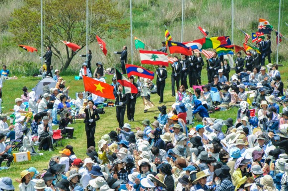 Flag bearers enter the Prayer Field during the 2015 SOPP at Fuji Sanctuary